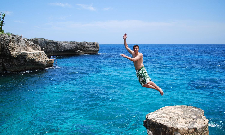 Jamaican cliff dive get lost magazine - Highest cliff dive ...